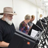More than 100 people in Baxter County had cast their ballots in this 2014 file photo during the first 90 minutes of early voting.