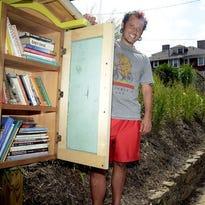 Jim Lazoun with his community Chere themed (see bottom left of box)  sharing book box at 85 Broad Street. John Coutlakis 7-18-14