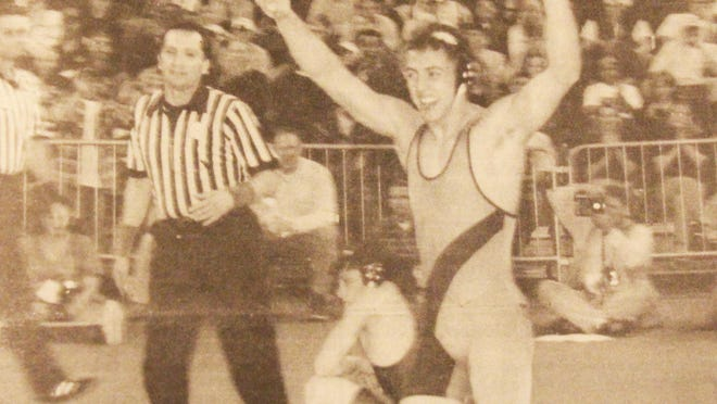 Simply the best: La Junta's four-time state champion Jared Haberman celebrates his 5-1 victory over Salida's Tony Cordova (background) Saturday (Feb. 20, 1999) night at McNichols Sports Arena. Haberman became just the eighth wrestler in the 64-year history of the state tournament to win four titles.