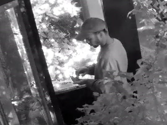 Police are searching for the man they say burglarized