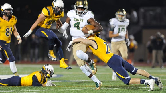 Whitnall defenders gave chase and attempted to stop Greenfield quarterback Rayvon Bartlett Jr. but could not haul him down as he raced 51 yards to the end zone. Bartlett led the Hustlin' Hawks to a 31-13 victory on Sept. 23.