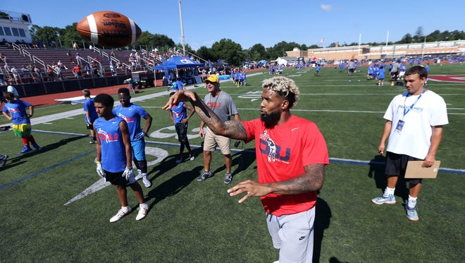 Giants star wide receiver Odell Beckham Jr. throws a pass to campers during receiving drills at his inaugural football camp at Boonton High School open to boys and girls grades 1-8. July 26, 2016, Boonton, NJ