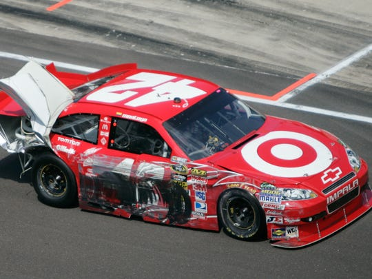 Juan Pablo Montoya heads for the garages after a collision