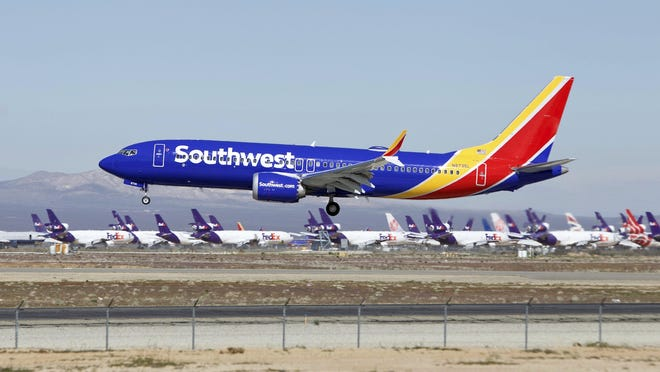 In this Saturday, March 23, 2019, photo, a Southwest Airlines Boeing 737 Max aircraft lands at the Southern California Logistics Airport in the high desert town of Victorville, Calif.