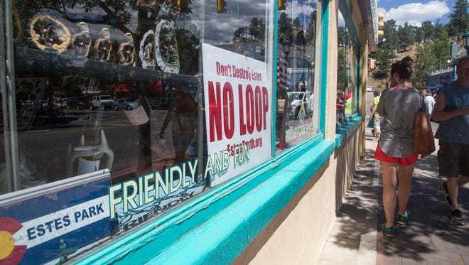Local businesses display signs against the loop proposed for Estes Park, Saturday, July 9, 2016. It would create a one-way loop around town toward Rocky Mountain National Park because traffic is becoming a problem. Business owners are upset thinking the loop will take traffic away from downtown and their businesses.