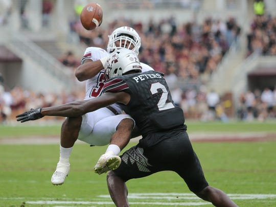 Mississippi State's Jamal Peters (2) jars the ball