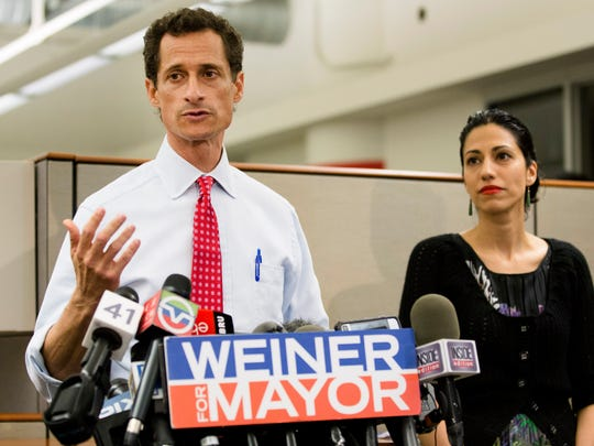 In this July 23, 2013, file photo, Anthony Weiner speaks during a news conference alongside his then-wife, Huma Abedin, in New York City.