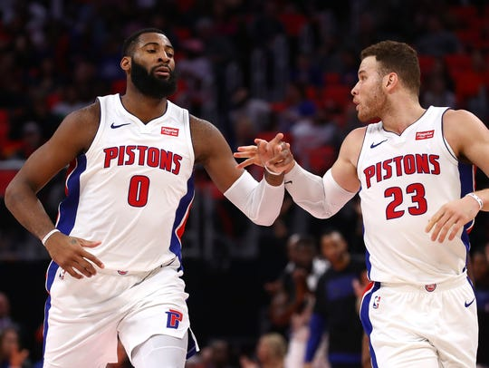 Pistons center Andre Drummond celebrates a second-half basket with Blake Griffin while playing the Hawks on Feb. 14.