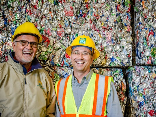 """Gil Valente, with Solid Waste Authority Recycled Material Processing, says, """"When in doubt, throw it out rather than contaminating the bins."""" Pictured are Valente, at left, and Willie Puz, Solid Waste Authority director Public Affairs and Recycling."""