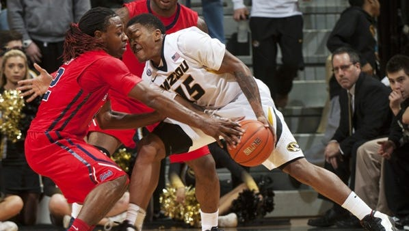 Missouri's Wes Clark, right, tries to push past Mississippi's Stefan Moody, left, and Martavious Newby during the second half of an NCAA college basketball game Saturday, Jan. 31, 2015, in Columbia, Mo. Mississippi won 67-47. (AP Photo/L.G. Patterson)