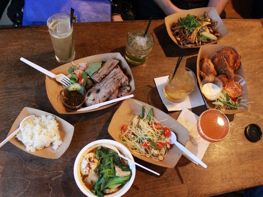 The Katoi menu includes, from top right, grilled mushrooms, Thai fried chicken, som tam, mama naam ramen, sticky rice, crying tiger smoked brisket. Drinks by Two James.
