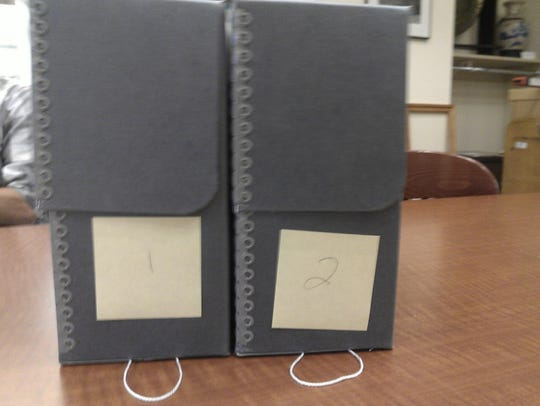 Two boxes contain the 1,529 Stearns County WPA Biographical