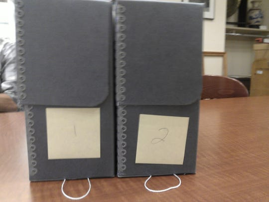 Two boxes contain the 1,529 Stearns County WPA Biographical Sketches.