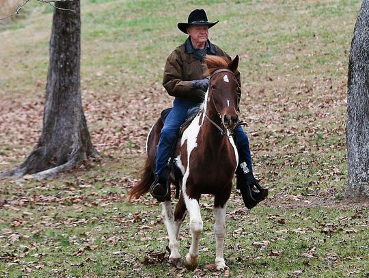 U.S. Senate candidate Roy Moore rides a horse to vote,