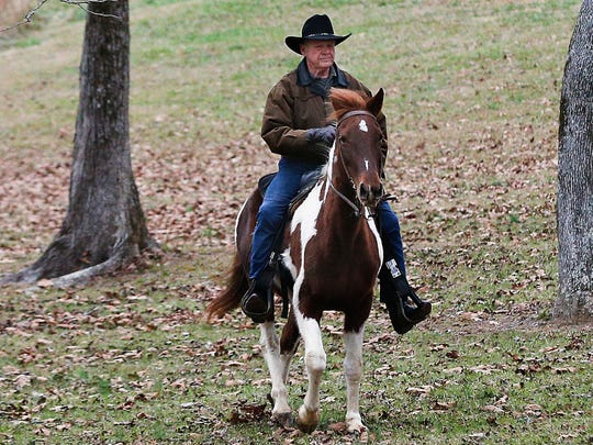 U.S. Senate candidate Roy Moore rides a horse to vote, Dec. 12, 2017, in Gallant, Ala.
