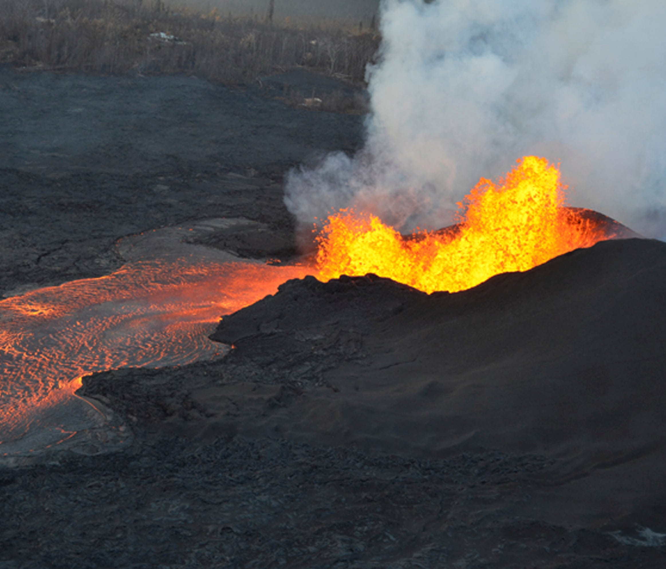 This photo provided by the U.S. Geological Survey shows lava fountaining at a fissure near Pahoa on the island of Hawaii Tuesday, June 5, 2018. Lava from Hawaii's Kilauea volcano destroyed hundreds more homes overnight, overtaking two oceanfront comm