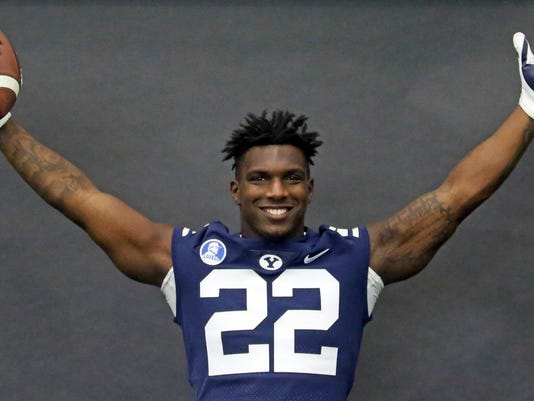 FILE - In this Aug. 2, 2017, file photo, BYU running back Squally Canada poses for photographs during the team's photo day, in Provo, Utah. (AP Photo/Rick Bowmer, File)