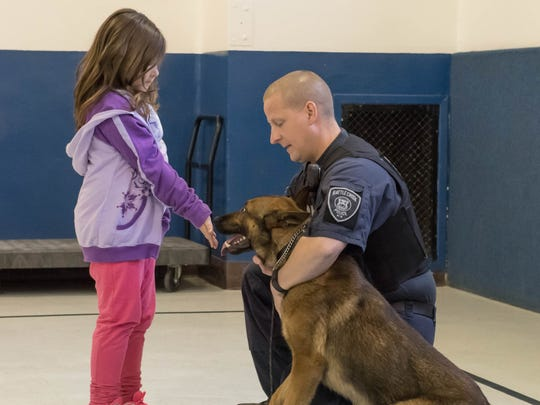 Battle Creek Police Sgt. Chad Fickle with police dog