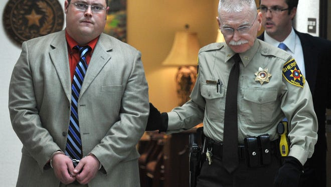 A Wichita county deputy walks Teddie Whitefield from the 30th district court room to jail after his sentencing on three counts of manslaughter.
