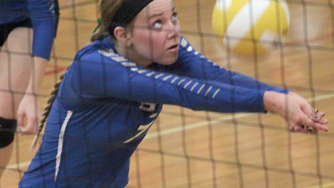 Senior Logan Farmer gets the ball in play during a match between Bondurant-Farrar and Harlan Nov. 3.
