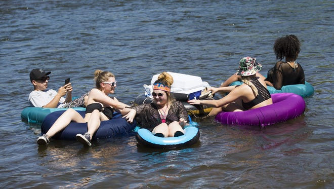 Tubers float down the Salt River in Mesa over Memorial Day weekend on May 29, 2017.