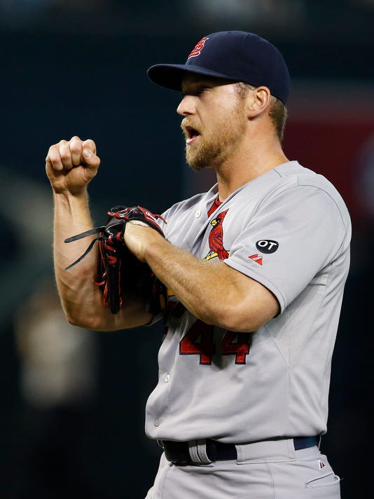 St. Louis Cardinals' Trevor Rosenthal celebrates after the final out of a baseball game against the Arizona Diamondbacks on Wednesday, Aug. 27, 2015, in Phoenix. The Cardinals defeated the Diamondbacks 5-3. (AP Photo/Ross D. Franklin)