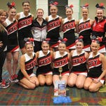 The 2015-2016 City High Varsity Dance Team qualified for UDA National Competition this week while at their Elite Dance Camp in Cedar Rapids. They earned third place in their Home Routine, as well as many blue ribbons. Hailey Fay and Grace Williamson were both awarded All-American. UDA Nationals is Jan. 29-31, 2016 at Walt Disney World in Orlando, FL, and this will be City High Dance Team's third consecutive trip to national competition. Pictured, from left back row, are Coach Barbie Kopp, Grace Williamson, Leigh Durian, Quincey Scholz, Elke Windschitl (team captain), Ella Grace Lowry, Cori Slocum and Abby Postman. Front row; Alivia Baldridge, Marissa Milavetz, Ellie Ballard, Amelia Cain and Hailey Fay.