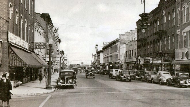 Front Street, Looking north from Garrison Street, Fremont,in the 1940s.  You had to be good at parallel parking to shop at Joseph's Department Store, seen here at the right before the 1948 fire.  Most of the historic buildings in this panoramic view are well preserved today.  Notice the globe light poles, the awnings that were still common then, and the shoppers going about their daily business.