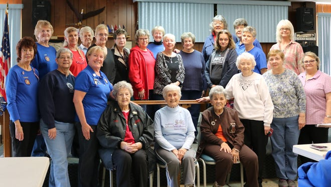 Elaine Bitout of Lakeview, seated in center chair, was recently presented her VFW 50-year membership pin.Members receiving 25-year pins were: Ruth Burroughs, Jenny Hargleroad, and Lynda Ross.A 20-year pin was presented to Barbara Burde. Those receiving their 15-year pin were Darlene Brakebill, Marilyn Cisowski, Sue Wogaskiand Rosemarie Ward. Ten-year pins went to Chloe Strecker, Marny Soluri, Dee Crawford, Janice Smith, Debbie Noirfalise, Louise Baudekand Dian Miller. Five-year pins were given to Connie Jacobs, Sandra Herd, Evelyn Miller, Elaine Volck, Chris Ross, Gerry Staranowiczand Chris Martin.