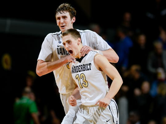 Vanderbilt forward/center Luke Kornet (3) and guard Riley LaChance (13) react after defeating Texas A&M at Memorial Gym in Nashville on Feb. 16, 2017.