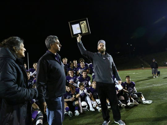 Shasta head coach J.C. Hunsaker holds up the championship plaque after Shasta beat 63-26 Chico in the playoff final game.  ///NSCIF - 2017, Division II Football Championship, Chico vs. Shasta, Saturday Nov. 25th, 2017 in the Thompson Field in Redding, CA. Shasta won the Division II Football Championship over Chico, 63 -26. ///(Photo by Hung T. Vu)