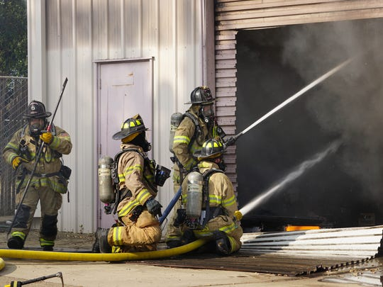 A  fire broke out Monday, June 18, 2018 on the northeast side of the Quality Acoustics warehouse. Redding firefighters from  engines 3 were the first to arrive at the scene along with Tower-1 truck. The cause of the fire is under investigation at the time the photos were taken.  (Special to the Record Searchlight by Hung T. Vu)