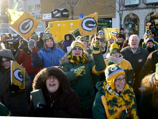 Packers fans get pumped up for Sunday's divisional playoff game against Dallas, during a pep rally Friday in downtown Green Bay.