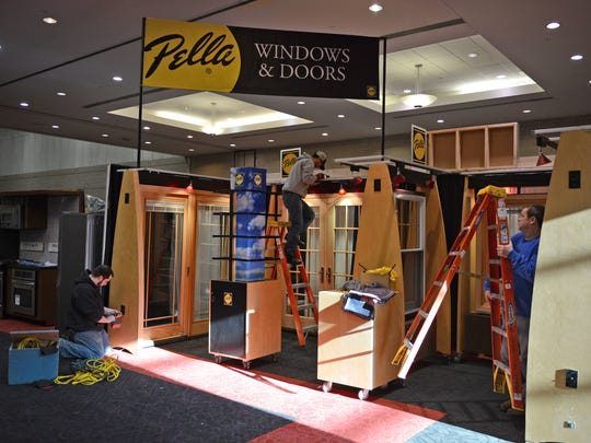 Vendors set up exhibits for the Brown County Home Builders