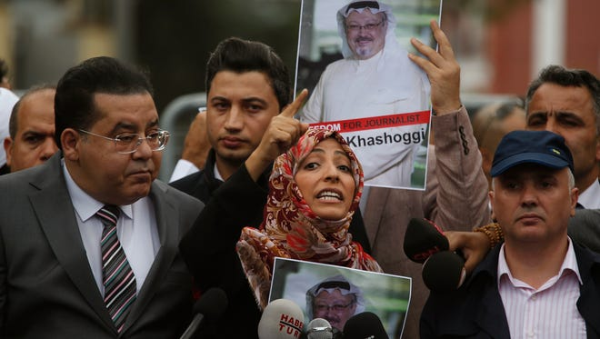 Tawakkol Karman, the Nobel Peace Prize laureate for 2011, gestures as she talks to members of the media about the disappearance of Saudi writer Jamal Khashoggi, near the Saudi Arabia consulate in Istanbul,  Oct. 8, 2018. Khashoggi, 59, went missing on Oct. 2 while on a visit to the consulate in Istanbul for paperwork to marry his Turkish fiance.  The consulate insists the writer left its premises, contradicting Turkish officials. He had been living since last year in the U.S. in a self-imposed exile, in part due to the rise of Prince Mohammed, the son of King Salman.