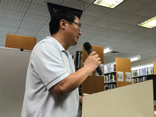 Millburn resident Jack Ouyang speaks at the podium