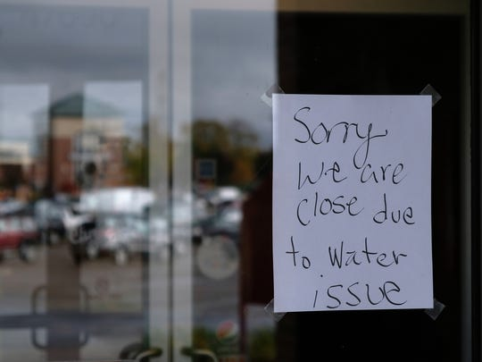 A sign stating the closure of La Herradura Mexican Restaurant due a boil advisory that was issued after a water main break occurred in Farmington is seen on Tuesday Oct. 24, 2017.