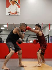 MMA coach Henry Cortez spars with Sergio Torres during a practice session at Fighterz Corner on Wednesday, May 3, 2017 in Salinas, Calif. The fighters are conditioning for an upcoming event. Vernon McKnight/for The Californian