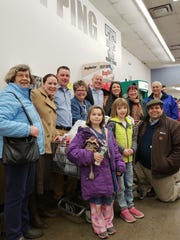 Participants and well-wishers gather to celebrate the Trumansburg Rotary Supermarket Sweepstakes Shopping Cart Dash.  Winner Mimi Duncan and runner Neil Clifford donated their haul to the Trumansburg Food Pantry and its Backpack Program.  Front row, left to right: Rotary kids Pelly Overbaugh and Margaret Bryant, Rotarian Bill Overbaugh Back row: Rotarians Kathleen Overbaugh and Shelly Bullock, Trumansburg Shur Save owner Brett Seafuse, Sweepstakes winner Mimi Duncan, runner, Neil Clifford, and Rotarians Melissa Bryant, Peggy Haine, and Tom Overbaugh.