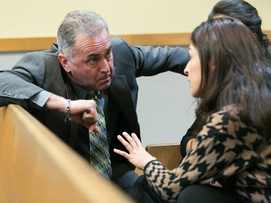 Doña Ana County District Attorney Mark D'Antonio speaks with embezzlement victim Maribel Samaniego on Friday in 3rd Judicial District Court during sentencing for former El Paso County Judge Anthony Cobos.