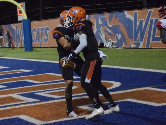 Louisiana College's Trey Turner (18, left) congratulations Leondre James (17, right) after James caught a two-point conversion pass against Sul Ross.