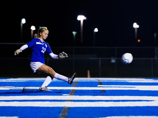 Jenna Moran, from Barron Collier High School, kicks the ball into play during the Class 3A regional semifinal against North Fort Myers High School at Barron Collier High School on Tuesday, January 31, 2017 in East Naples. North Fort Myers High scored during the second half and will move on to Friday's championship game.