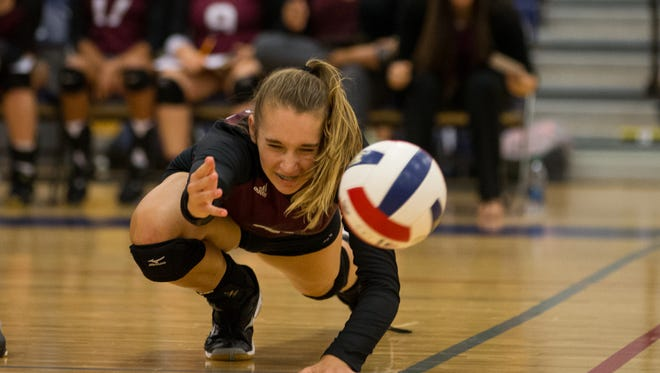 Flour Bluff's Mackenzie Wiggins dives the for the ball during their game against Veterans Memorial at Veterans Memorial on Tuesday, Sept. 19, 2017.