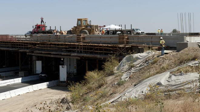 Construction continues on the Cartmill Interchange in Tulare at Highway 99 on Monday, August 24, 2015.