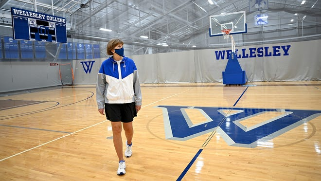 Kathy Hagerstrom, the assistant director of equipment and operations at Wellesley College's Keohane Sports Center, walks across the college's basketball court on Saturday morning. The former women's basketball coach at Wellesley often has the field house to herself.