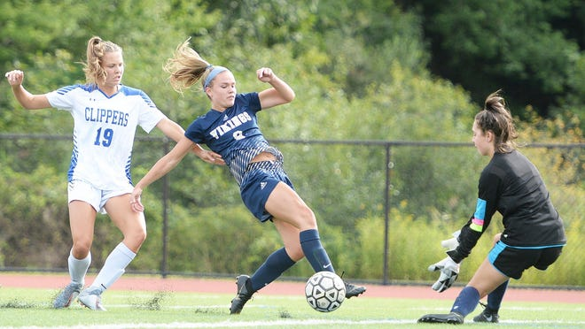 East Bridgewater's Emily McCormack takes a shot on Norwell goalkeeper Casey Ward during their game on Thursday, Sept. 5, 2019. Norwell's Anna Kirchner looks on.