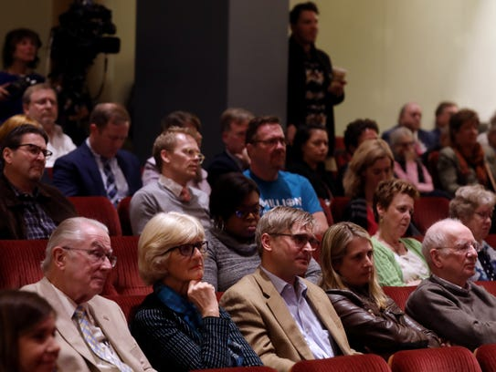 Members of the audience listen during The Tennessean's