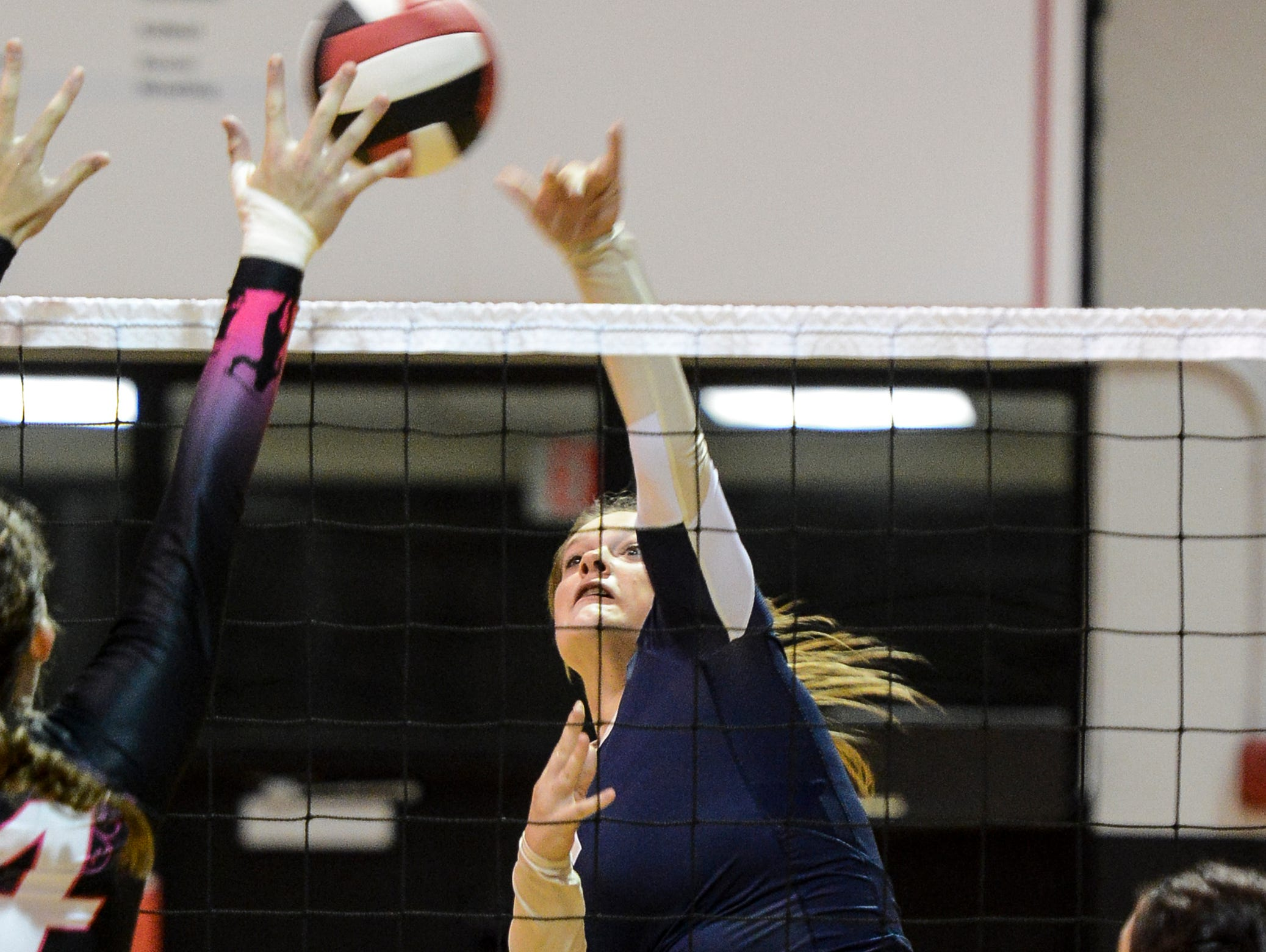 Sammie Streeter of Eau Gallie spikes the ball during a match against Palm Bay.