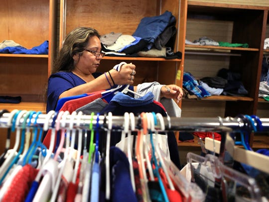 Dolores Muñoz shops for clothing at the Quiet Time