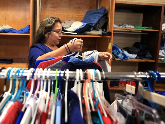 Dolores Muñoz shops for clothing at the Quiet Time Ministries food bank on Tuesday, February 14, 2016. In addition to the food bank, people are able to get clothing items.